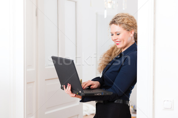 Internet Dating - Woman at home after work Stock photo © Kzenon