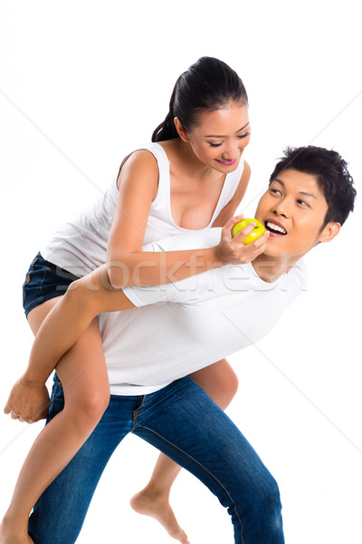 Asian couple eating and living healthy Stock photo © Kzenon