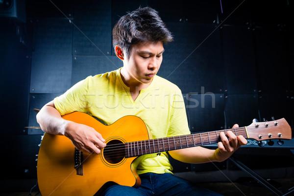 ázsiai gitáros játszik zene zenei stúdió profi Stock fotó © Kzenon