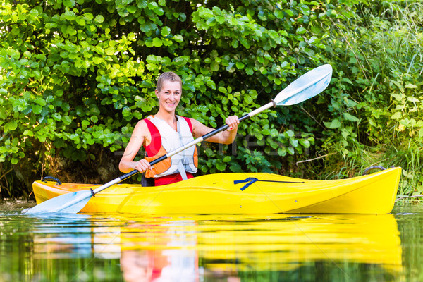 Woman driving with kayak on forest river Stock photo © Kzenon