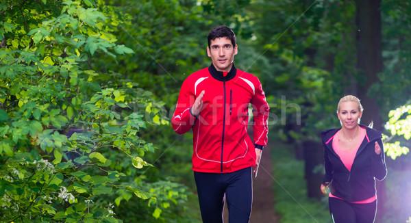 Pár fut erdő jobb fitnessz férfi Stock fotó © Kzenon