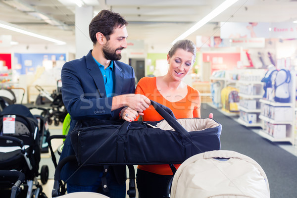 Couple in baby shop buying stroller Stock photo © Kzenon