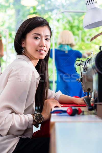 Asian tailor woman sewing dress with machine  Stock photo © Kzenon