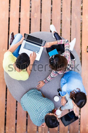 Young employees using modern wireless technology while working o Stock photo © Kzenon