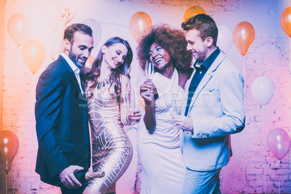 Couples in a club celebrating new years eve dancing into midnigh Stock photo © Kzenon