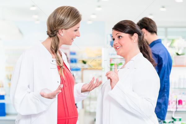 Pregnant pharmacist in protective employment ban  Stock photo © Kzenon