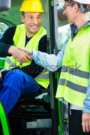 Medic and emergency doctor approaching site of accident Stock photo © Kzenon
