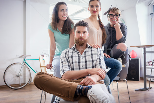 four co-workers wearing casual clothes during work in a modern hub Stock photo © Kzenon
