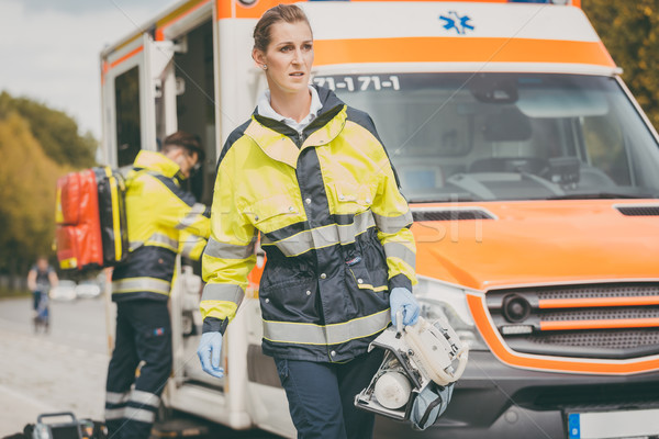 Paramedic nurse and emergency doctor at ambulance Stock photo © Kzenon