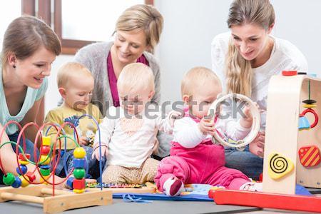 три счастливым смотрят младенцы играет Сток-фото © Kzenon