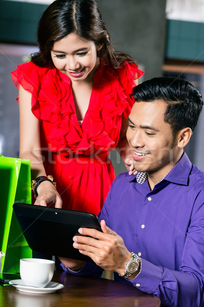 Young couple watching a funny video on a tablet connected to the internet Stock photo © Kzenon