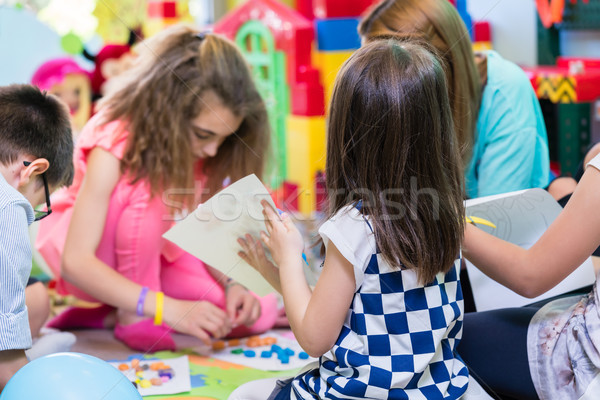 Group of kids applying colorful plasticine during educational activity Stock photo © Kzenon