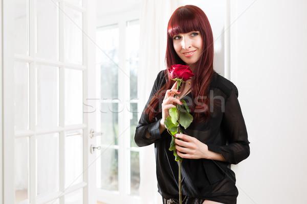 Happy woman holding red rose Stock photo © Kzenon