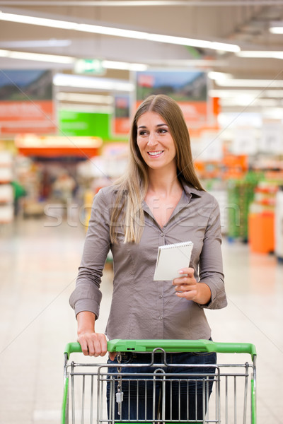 Woman Shopping with Checklist and Trolley Stock photo © Kzenon