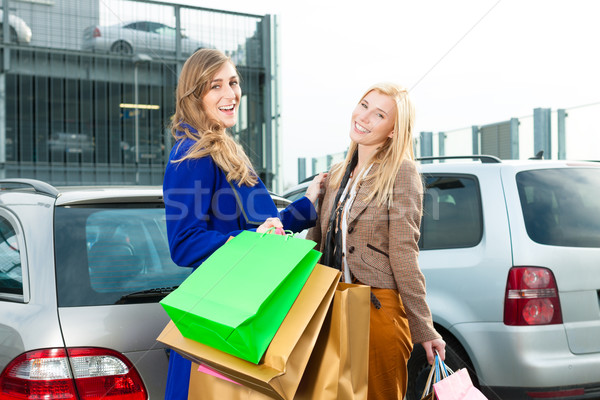 Two women were shopping and driving home Stock photo © Kzenon