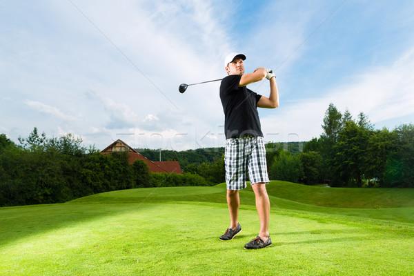 Jovem jogador de golfe golfe balançar Foto stock © Kzenon