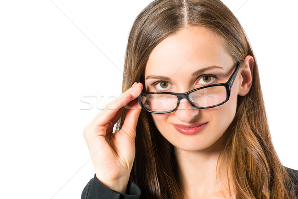 Young woman with glasses looking Stock photo © Kzenon