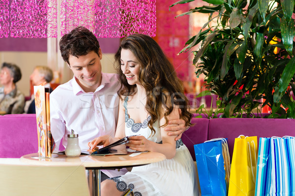 Young couple enjoying coffee after shopping Stock photo © Kzenon