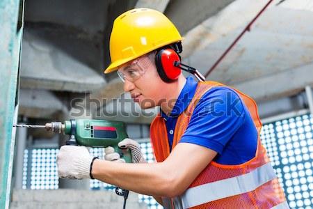 Сток-фото: азиатских · работник · бурение · строительная · площадка · стены · индонезийский