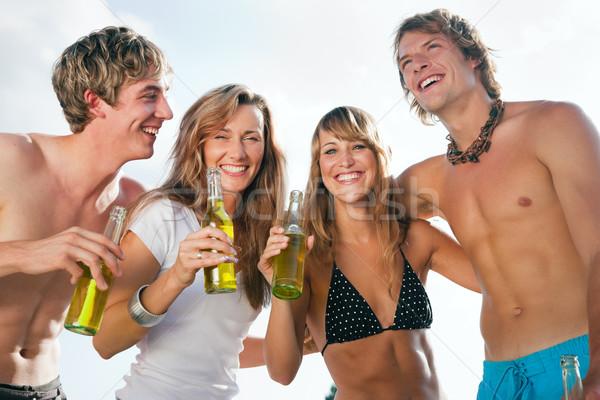 Cuatro personas playa fiesta grupo cuatro Foto stock © Kzenon