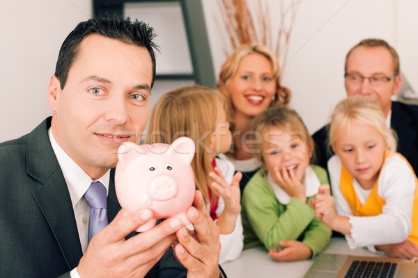 Family with consultant - finance and insurance Stock photo © Kzenon
