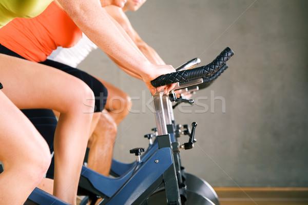 Gymnasium fietsen drie mensen fiets Stockfoto © Kzenon