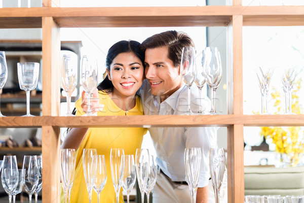 Couple in furniture store choosing glasses Stock photo © Kzenon