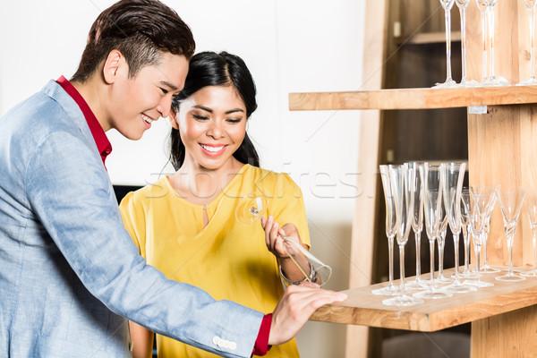 Asian couple buying stuff in furniture store Stock photo © Kzenon