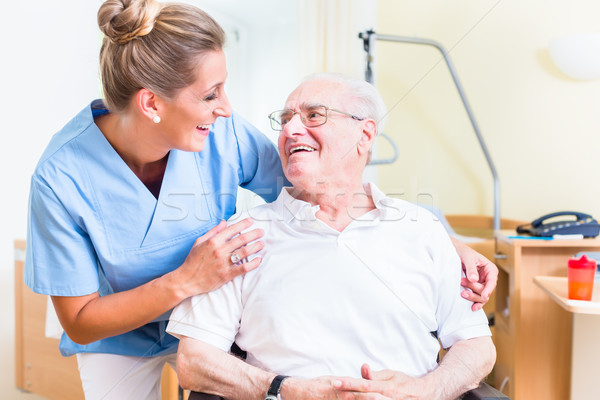 Senior man and old age nurse in nursing home Stock photo © Kzenon