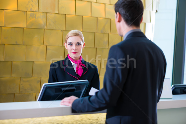 Hotel receptionist check in man giving key card Stock photo © Kzenon