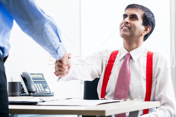 Business partners shaking hands in office  Stock photo © Kzenon