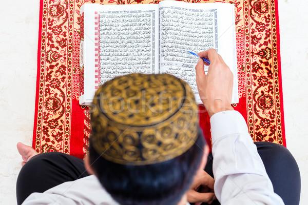 Asian Muslim man studying Koran or Quran Stock photo © Kzenon