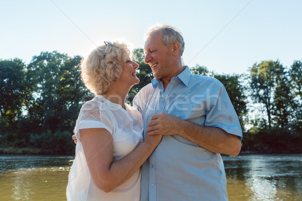 Stock photo: Romantic senior couple enjoying a healthy and active lifestyle outdoors