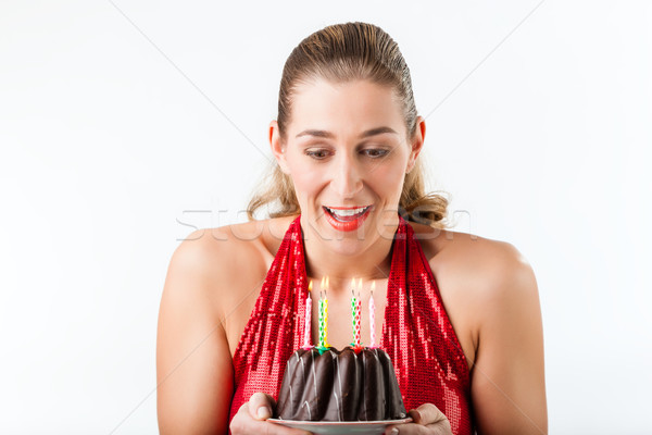 Woman celebrating birthday with cake and candles Stock photo © Kzenon