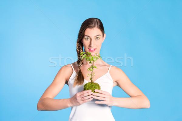 Young Woman holding a small tree Stock photo © Kzenon