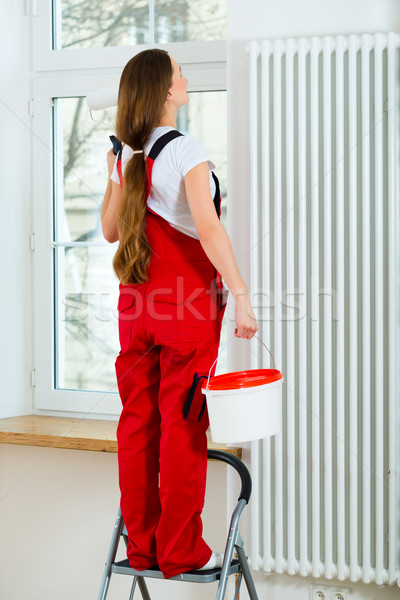 Woman in her house renovating and painting Stock photo © Kzenon