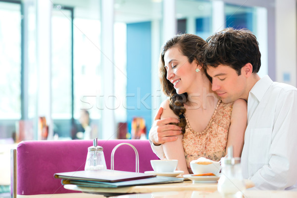 Young couple cafe hugging and kissing Stock photo © Kzenon