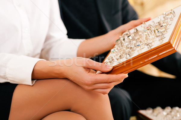 Couple choosing a ring at the jeweller Stock photo © Kzenon