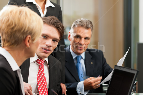 Business - team meeting in an office Stock photo © Kzenon