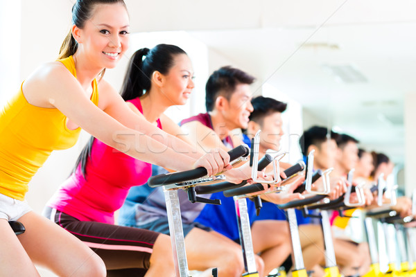 Stock photo: Asian people in spinning bike training at fitness gym