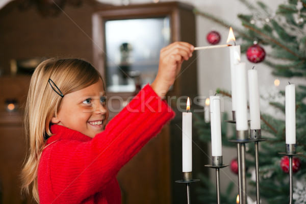Stock photo: Child lighting Christmas candles