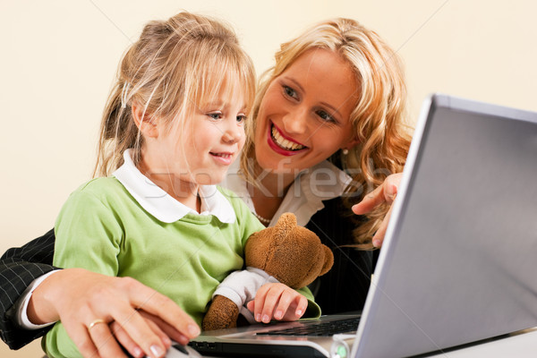 Businesswoman and mother showing kid the internet Stock photo © Kzenon