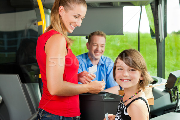 Mother and child boarding a bus Stock photo © Kzenon
