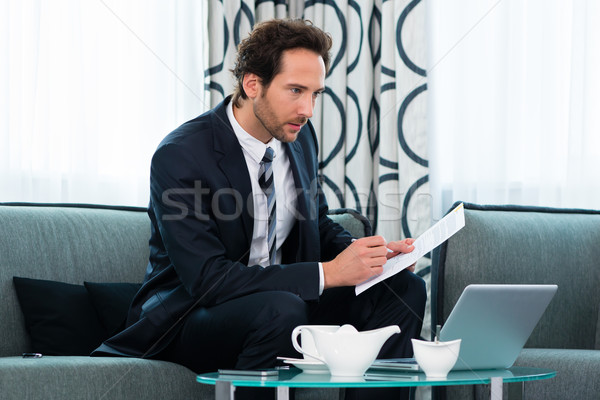 businessman in hotel working with agreement Stock photo © Kzenon