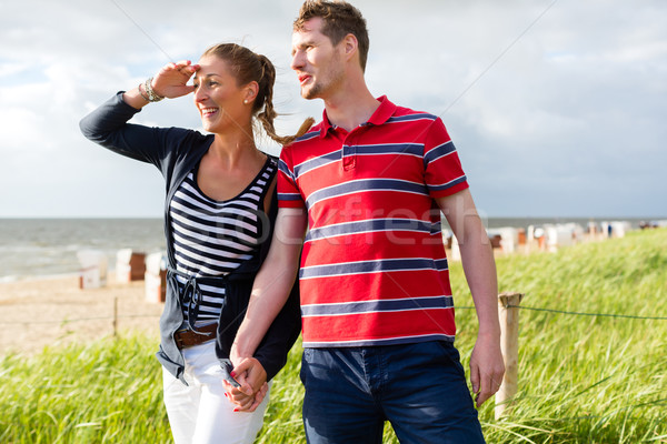 Couple enjoying holiday in beach dune Stock photo © Kzenon