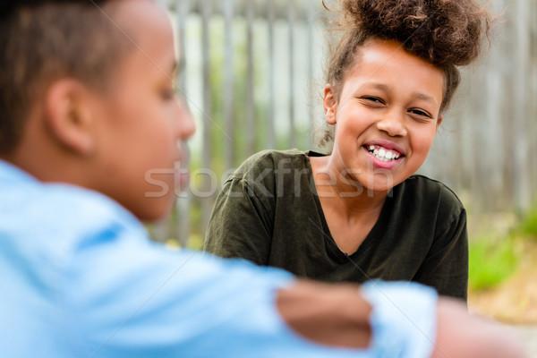 Siblings sitting on floor in yard Stock photo © Kzenon