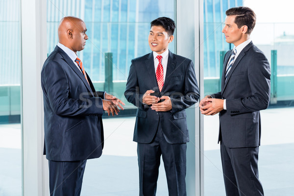 Asian Business team reporting to Indian CEO Stock photo © Kzenon