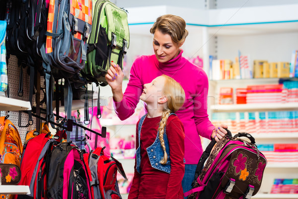 Family buying school satchel or bag in store Stock photo © Kzenon