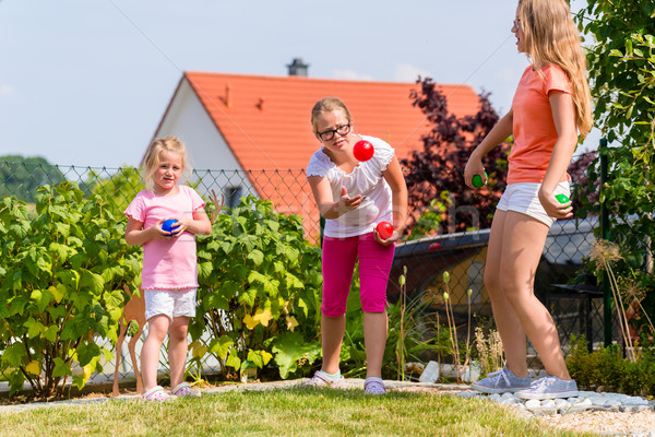 Sisters playing bocce in garden front or their home Stock photo © Kzenon