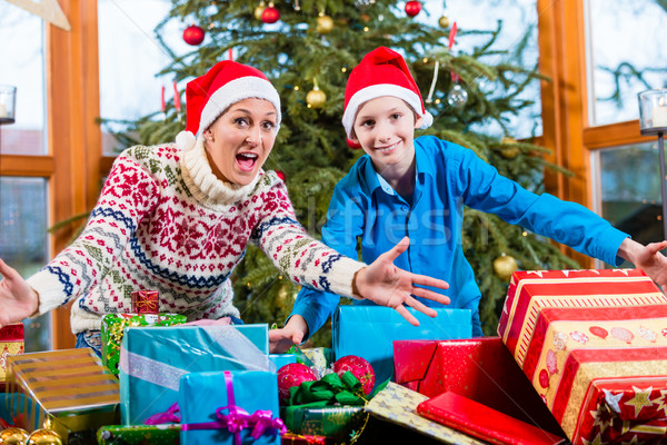 Woman and child on Christmas with wrapped gifts and Santa Claus  Stock photo © Kzenon